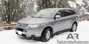 2014 Mitsubishi Outlander Exterior Front Side Snow 2